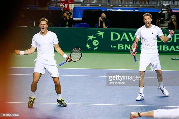 Vasek Pospisil and Daniel Nestor of Canada celebrate their Davis Cup doubles match win over Japan March 7 2015 in Vancouver British Columbia Canada...
