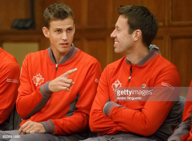 Vasek Pospisil and Daniel Nestor of Canada talk during the draw ceremony of the Davis Cup World Group tie between Great Britain and Canada at...