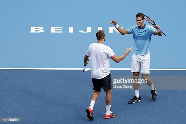 Vasek Pospisil of Canada and Jack Sock of the United States celebrates after winning their Mens's doubles final match against Daniel Nestor of Canada...