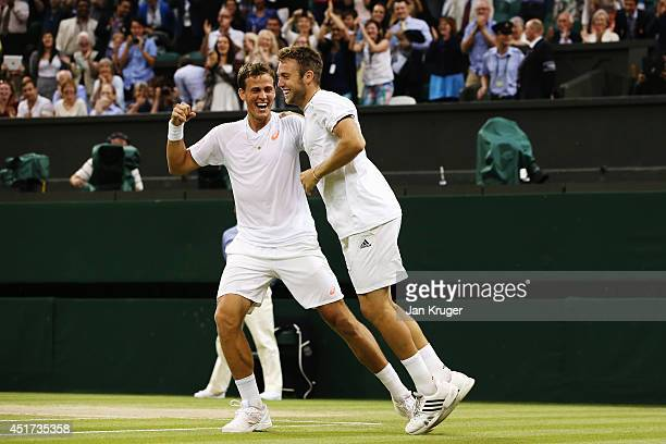 Vasek Pospisil of Canada and Jack Sock of the United States celebrate after winning the Gentlemen's Doubles Final against Bob Bryan and Mike Bryan of...