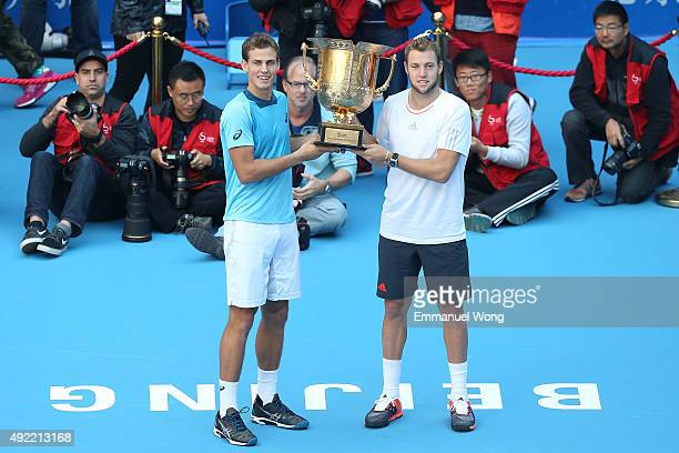 Vasek Pospisil of Canada and Jack Sock of the United States pose with their trophy after winning the Mens's doubles final match against Daniel Nestor...