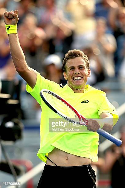 Vasek Pospisil of Canada celebrates his win over John Isner of the United States during the Rogers Cup at Uniprix Stadium on August 6 2013 in...