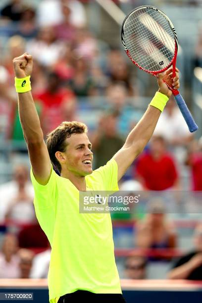 Vasek Pospisil of Canada celebrates match point against John Isner of the United States during the Rogers Cup at Uniprix Stadium on August 6 2013 in...