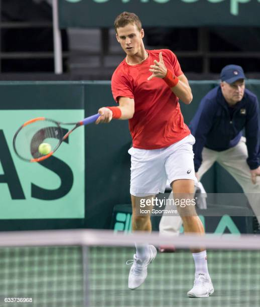 Vasek Pospisil of Canada hits a forehand to Kyle Edmund of Great Britain in the BNP Paribas Davis Cup Tennis Canada v Great Britain team match on...