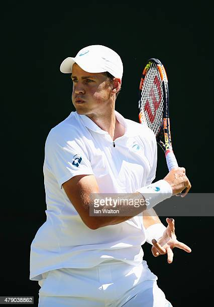 Vasek Pospisil of Canada in action in his Gentlemen's Singles first round match against Vincent Millot of France during day two of the Wimbledon Lawn...