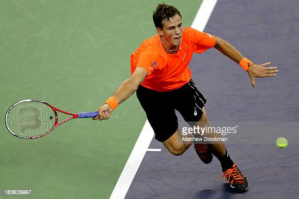 Vasek Pospisil of Canada lunges for a shot while playing Richard Gasquet of France during the Shanghai Rolex Masters at the Qi Zhong Tennis Center on...