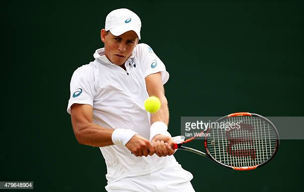 Vasek Pospisil of Canada plays a backhand in his Gentlemen's Singles Fourth Round match against Viktor Troicki of Serbia during day seven of the...