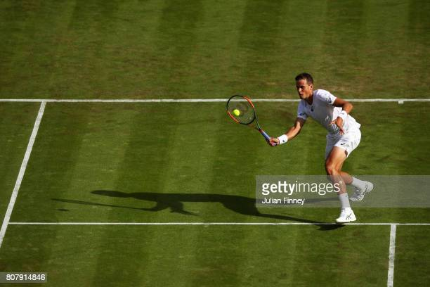 Vasek Pospisil of Canada plays a forehand during the Gentlemen's Singles first round match against Dominic Thiem of Austria on day two of the...