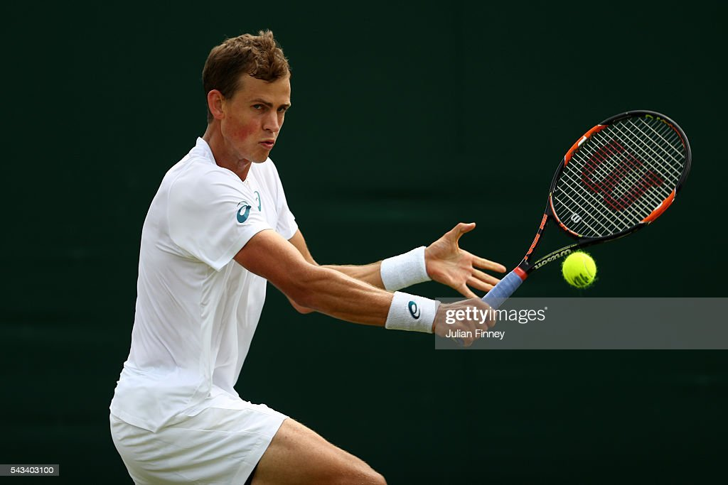 <a gi-track='captionPersonalityLinkClicked' href=/galleries/search?phrase=Vasek+Pospisil&family=editorial&specificpeople=5421228 ng-click='$event.stopPropagation()'>Vasek Pospisil</a> of Canada plays a forehand during the Men's Singles first round match against Albert Ramos-Vinolas of Spain on day two of the Wimbledon Lawn Tennis Championships at the All England Lawn Tennis and Croquet Club on June 28, 2016 in London, England.