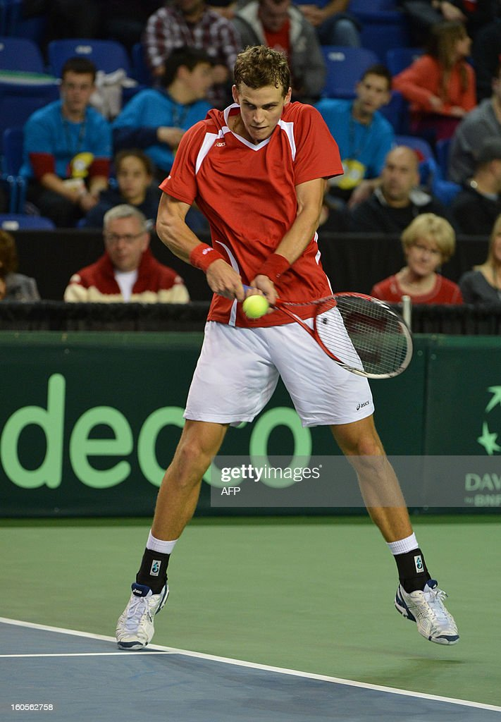 Vasek Pospisil of Canada plays against Marcel Granollers and Marc Lopez of Spain during a Davis Cup World Group Doubles Rubber, February 2, 2013, at the Doug Mitchell Thunderbird Sports Centre, in Vancouver, BC. AFP PHOTO / Don MACKINNON