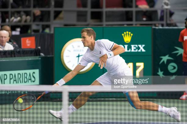Vasek Pospisil of Canada reaches to return a shot against Dominic Inglot and Jamie Murray of Great Britain in men's doubles play on February 04 2017...
