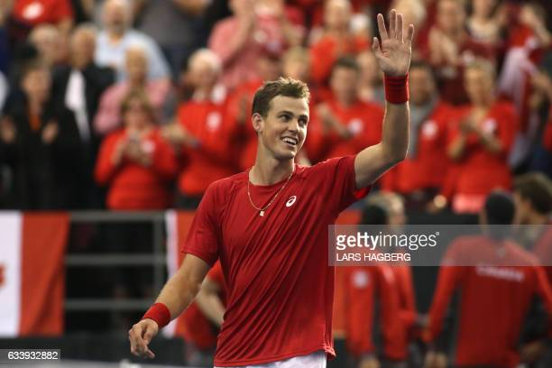Vasek Pospisil of Canada reacts after beating Daniel Evans of Great Britain 41 on the third day of Davis Cup first round between Canada and Great...