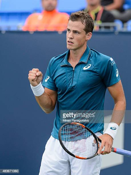Vasek Pospisil of Canada reacts after scoring a point against YenHsun Lu of Taiwan during day two of the Rogers Cup at Uniprix Stadium on August 11...