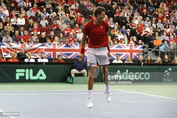 Vasek Pospisil of Canada reacts after winning a break point against Daniel Evans of Great Britain during the end of the fourth set on the third day...