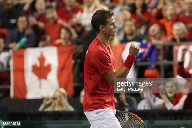 Vasek Pospisil of Canada reacts after winning a point against Daniel Evans of Great Britain during the end of the third set on the third day of Davis...