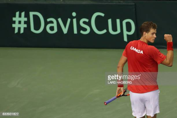 Vasek Pospisil of Canada reacts after winning a point against Daniel Evans of Great Britain during the end of the fourth set on the third day of...
