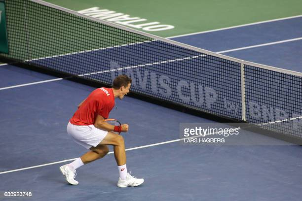 Vasek Pospisil of Canada reacts after winning the second set against Daniel Evans of Great Britain during the third day of Davis Cup first round...
