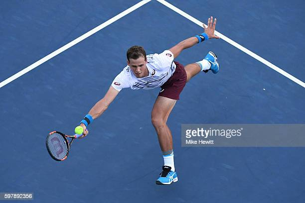 Vasek Pospisil of Canada returns a shot to Jozef Kovalik of Slovakia during his first round Men's Singles match on Day One of the 2016 US Open at the...