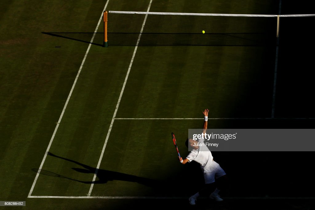 Vasek Pospisil of Canada serves during the Gentlemen's Singles first round match against Dominic Thiem of Austria on day two of the Wimbledon Lawn Tennis Championships at the All England Lawn Tennis and Croquet Club on July 4, 2017 in London, England.