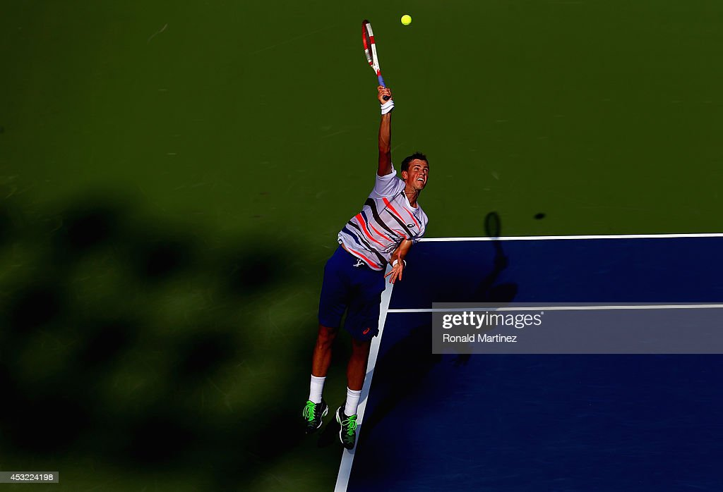 Vasek Pospisil of Canada serves to Richard Gasquet of France during Rogers Cup at Rexall Centre at York University on August 5, 2014 in Toronto, Canada.