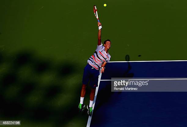 Vasek Pospisil of Canada serves to Richard Gasquet of France during Rogers Cup at Rexall Centre at York University on August 5 2014 in Toronto Canada