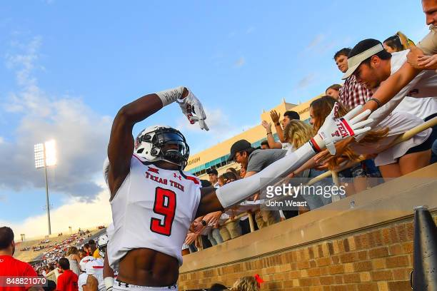 J Vasher of the Texas Tech Red Raiders interacts with fans before the game between the Texas Tech Red Raiders and the Arizona State Sun Devils on...