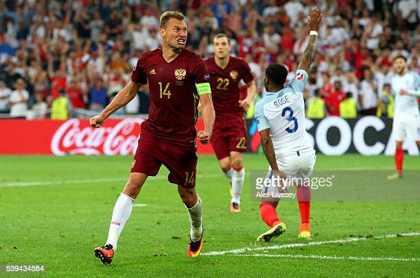 Vasili Berezutski of Russia celebrates as he scores his team's first goal during the UEFA EURO 2016 Group B match between England and Russia at Stade...
