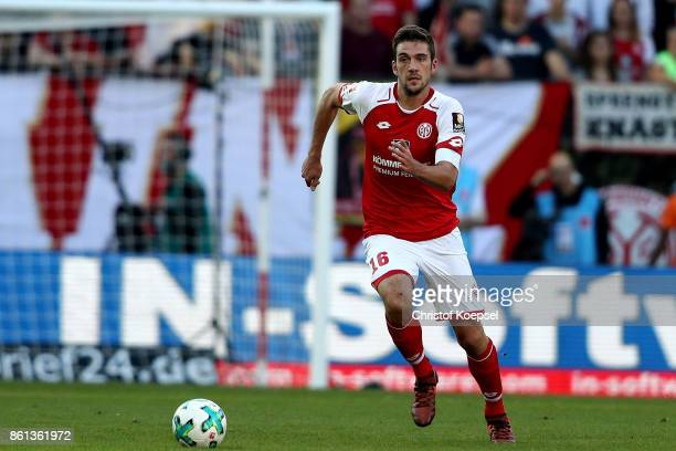 Vasilije Janjicic of Mainz runs with the ball during the Bundesliga match between 1 FSV Mainz 05 and Hamburger SV at Opel Arena on October 14 2017 in...