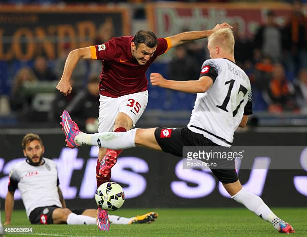 Vasilis Torosidis of AS Roma competes for the ball with AC Cesena players during the Serie A match between AS Roma and AC Cesena at Stadio Olimpico...