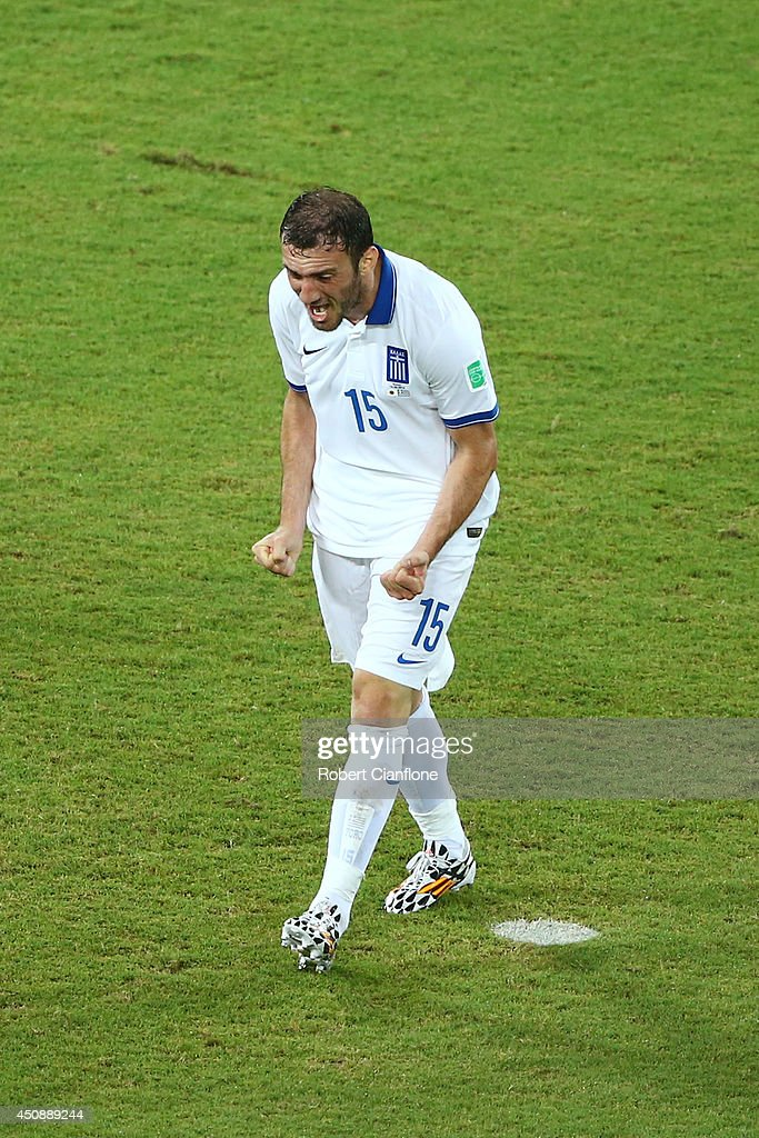 <a gi-track='captionPersonalityLinkClicked' href=/galleries/search?phrase=Vasilis+Torosidis&family=editorial&specificpeople=4542702 ng-click='$event.stopPropagation()'>Vasilis Torosidis</a> of Greece reacts after a missed chance during the 2014 FIFA World Cup Brazil Group C match between Japan and Greece at Estadio das Dunas on June 19, 2014 in Natal, Brazil.