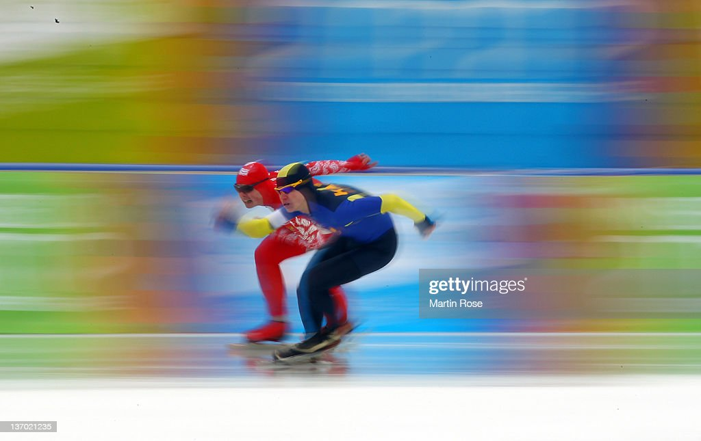 Vasiliy Pudushkin (L) of Russia and Stanislav Palkin (R) of Kazakhstan compete during the men's 500m race at the Skating Oval during the Winter Youth Olympic Games on January 12, 2012 in Innsbruck, Austria.