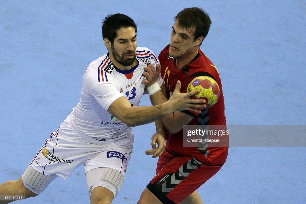 Vasko Sevaljevic of Montenegro (R) defends against <a gi-track='captionPersonalityLinkClicked' href=/galleries/search?phrase=Nikola+Karabatic&family=editorial&specificpeople=620415 ng-click='$event.stopPropagation()'>Nikola Karabatic</a> of France (L) during the premilary group A match between Montenegro and France at Palacio de Deportes de Granollers on January 13, 2013 in Granollers, Spain.