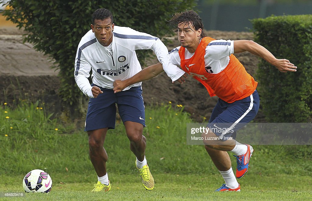 Vasquez Fredy Alejandro Guarin competes for the ball with <a gi-track='captionPersonalityLinkClicked' href=/galleries/search?phrase=Rene+Krhin&family=editorial&specificpeople=6234742 ng-click='$event.stopPropagation()'>Rene Krhin</a> of FC Internazionale Milano looks on during FC Internazionale Training Session at the club's training ground on August 29, 2014 in Appiano Gentile Como, Italy.