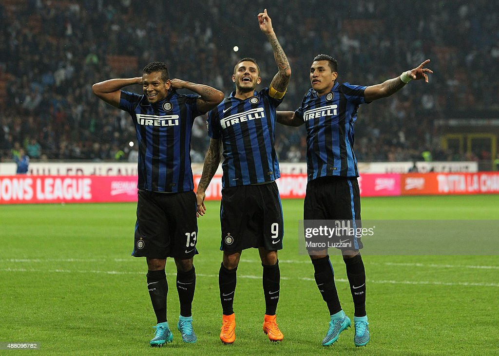 Vasquez Fredy Alejandro Guarin, Mauro Emanuel Icardi and Jeison Murillo celebrate a victory at the end of the Serie A match between FC Internazionale Milano and AC Milan at Stadio Giuseppe Meazza on September 13, 2015 in Milan, Italy.