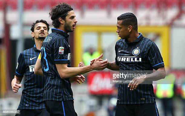 Vasquez Fredy Alejandro Guarin of FC Internazionale Milano celebrates with his teammate Andrea Ranocchia after scoring the opening goal during the...