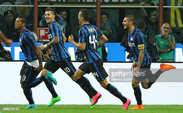 Vasquez Fredy Alejandro Guarin of FC Internazionale Milano celebrates with his teammates after scoring the opening goal during the Serie A match...