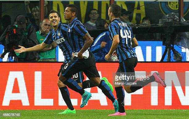 Vasquez Fredy Alejandro Guarin of FC Internazionale Milano celebrates with his teammates Stevan Jovetic and Ivan Perisic after scoring the opening...