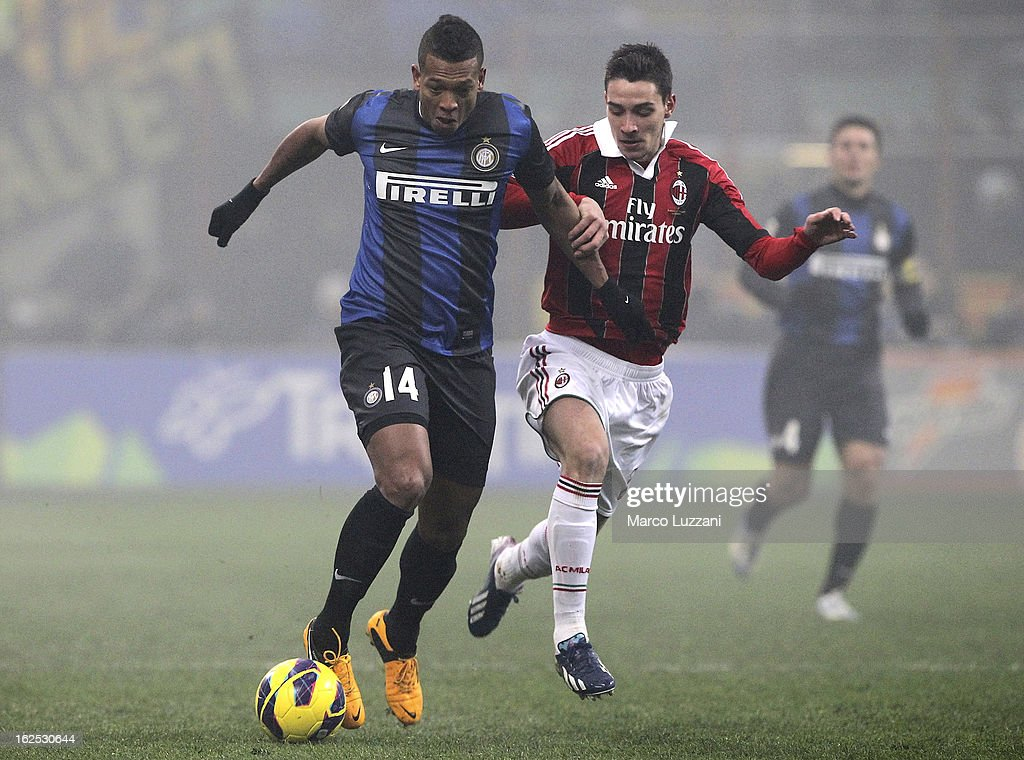 Vasquez Fredy Alejandro Guarin of FC Internazionale Milano competes for the ball with Mattia De Sciglio of AC Milan during the Serie A match FC Internazionale Milano and AC Milan at San Siro Stadium on February 24, 2013 in Milan, Italy.
