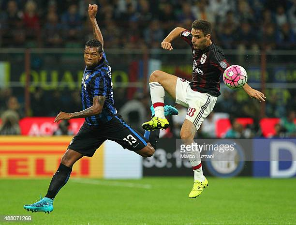 Vasquez Fredy Alejandro Guarin of FC Internazionale Milano competes for the ball with Giacomo Bonaventura of AC Milan during the Serie A match...