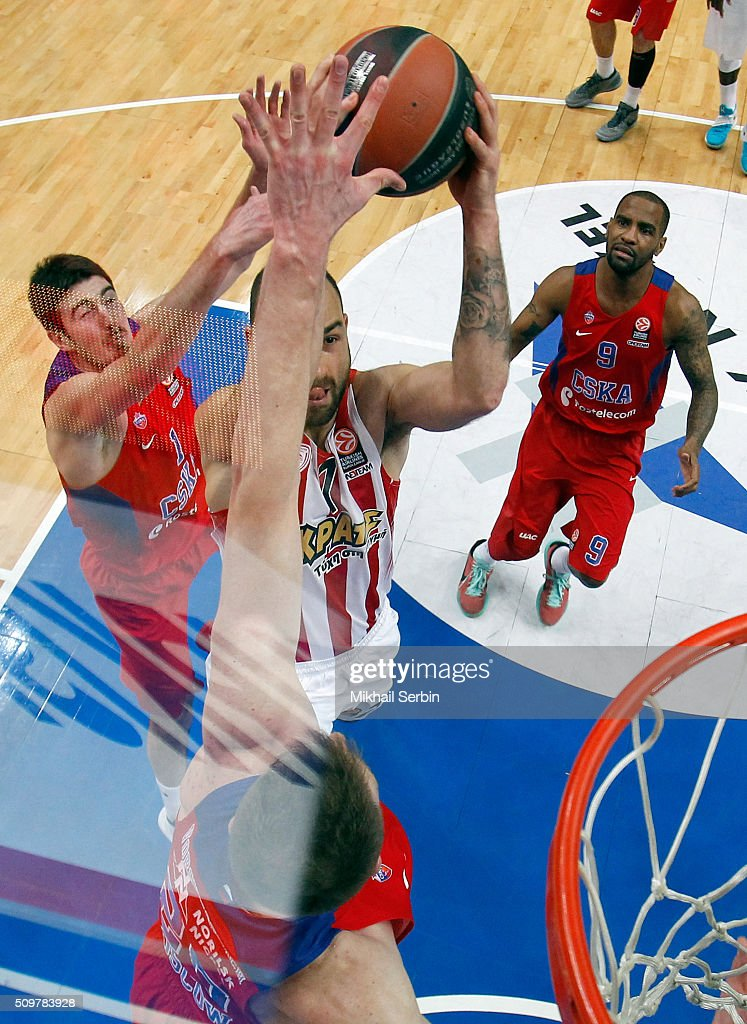 Vassilis Mouratos, #12 of Olympiacos Piraeus competes with <a gi-track='captionPersonalityLinkClicked' href=/galleries/search?phrase=Nando+De+Colo&family=editorial&specificpeople=4689603 ng-click='$event.stopPropagation()'>Nando De Colo</a>, #1 of CSKA Moscow in action during the Turkish Airlines Euroleague Basketball Top 16 Round 7 game between CSKA Moscow v Olympiacos Piraeus at Megasport Arena on February 12, 2016 in Moscow, Russia.