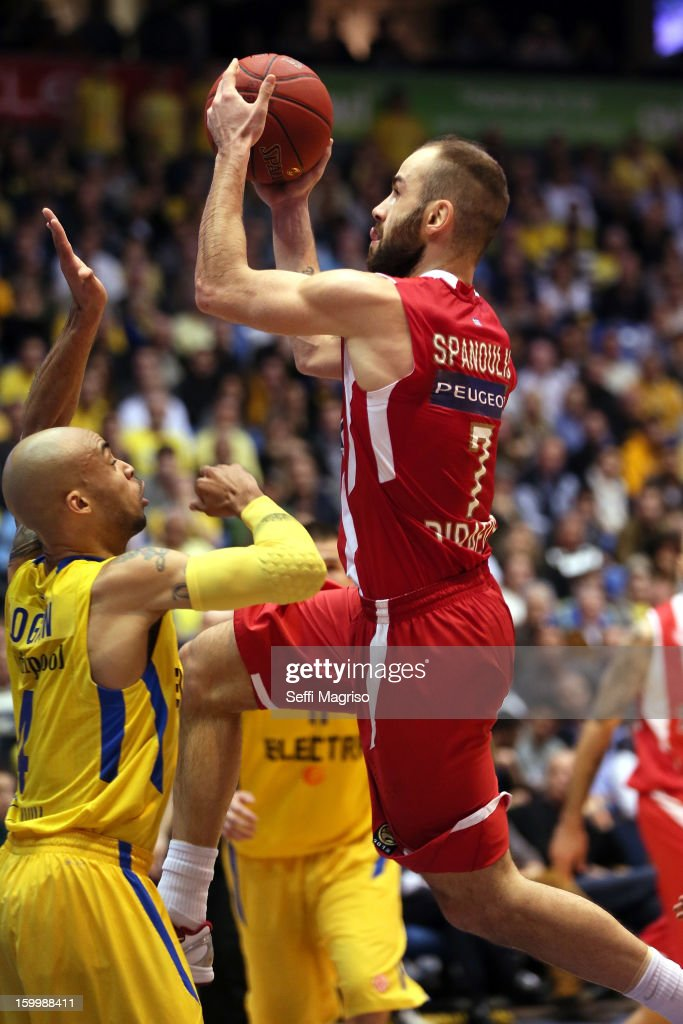 <a gi-track='captionPersonalityLinkClicked' href=/galleries/search?phrase=Vassilis+Spanoulis&family=editorial&specificpeople=704857 ng-click='$event.stopPropagation()'>Vassilis Spanoulis</a>, #7 of Olympiacos Piraeus competes with David Logan, #4 of Maccabi Electra Tel Aviv during the 2012-2013 Turkish Airlines Euroleague Top 16 Date 5 between Maccabi Electra Tel Aviv v Olympiacos Piraeus at Nokia Arena on January 24, 2013 in Tel Aviv, Israel.