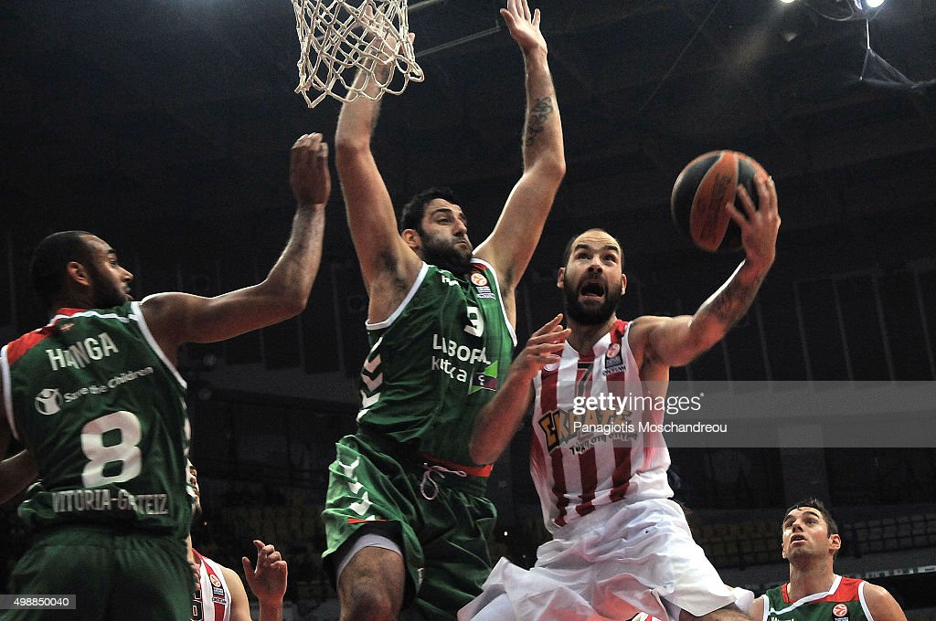 <a gi-track='captionPersonalityLinkClicked' href=/galleries/search?phrase=Vassilis+Spanoulis&family=editorial&specificpeople=704857 ng-click='$event.stopPropagation()'>Vassilis Spanoulis</a>, #7 of Olympiacos Piraeus competes with <a gi-track='captionPersonalityLinkClicked' href=/galleries/search?phrase=Ioannis+Bourousis&family=editorial&specificpeople=2114420 ng-click='$event.stopPropagation()'>Ioannis Bourousis</a>, #9 of Laboral Kutxa Vitoria Gasteiz during the Turkish Airlines Euroleague Regular Season Round 7 game between Olympiacos Piraeus v Laboral Kutxa Vitoria Gasteiz at the Peace and Friendship Stadium on November 26, 2015 in Heraklion, Crete, Greece.