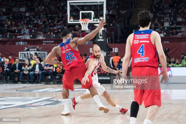 Vassilis Spanoulis #7 of Olympiacos Piraeus competes with Kyle Hines #42 of CSKA Moscow during the Turkish Airlines EuroLeague Final Four Semifinal B...