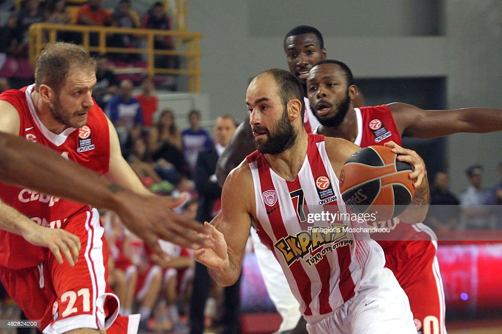 <a gi-track='captionPersonalityLinkClicked' href=/galleries/search?phrase=Vassilis+Spanoulis&family=editorial&specificpeople=704857 ng-click='$event.stopPropagation()'>Vassilis Spanoulis</a>, #7 of Olympiacos Piraeus competes with Luka Zoric, #21 of Cedevita Zagreb during the Turkish Airlines Euroleague Basketball Regular Season Date 1 game Olympiacos Piraeus v Cedevita Zagreb at Heraklion Arena on October 15, 2015 in Heraklion, Greece.