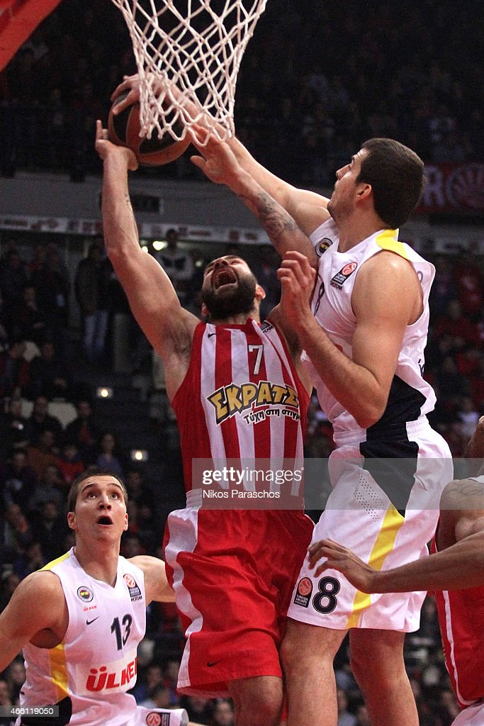 Vassilis Spanoulis, #7 of Olympiacos Piraeus competes with Nemanja Bjelica, #8 of Fenerbahce Ulker Istanbu during the Turkish Airlines Euroleague Basketball Top 16 Date 10 game between Olympiacos Piraeus v Fenerbahce Ulker Istanbul at Peace and Friendship Stadium on March 13, 2015 in Athens, Greece.