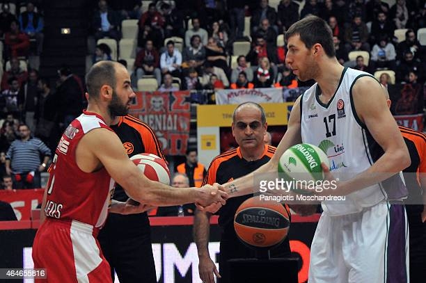 Vassilis Spanoulis #7 of Olympiacos Piraeus exchange ball with Fran Vazquez #17 of Unicaja Malaga during the Turkish Airlines Euroleague Basketball...
