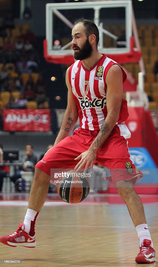 <a gi-track='captionPersonalityLinkClicked' href=/galleries/search?phrase=Vassilis+Spanoulis&family=editorial&specificpeople=704857 ng-click='$event.stopPropagation()'>Vassilis Spanoulis</a>, #7 of Olympiacos Piraeus in action during the 2013-2014 Turkish Airlines Euroleague Regular Season date 1 game between Olympiacos Piraeus v Unicaja Malaga at Peace and Friendship Stadium on October 18, 2013 in Athens, Greece.