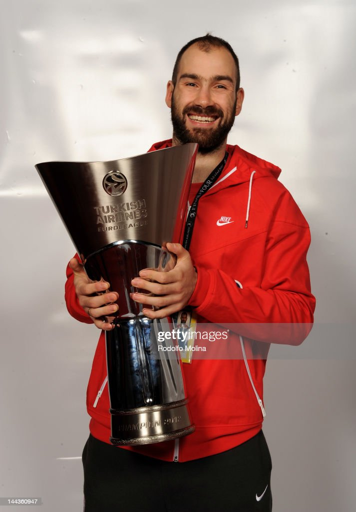 <a gi-track='captionPersonalityLinkClicked' href=/galleries/search?phrase=Vassilis+Spanoulis&family=editorial&specificpeople=704857 ng-click='$event.stopPropagation()'>Vassilis Spanoulis</a>, #7 of Olympiacos Piraeus poses with the trophy following his team's victory at the end of the Turkish Airlines EuroLeague Final Four Final match between CSKA Moscow and Olympiacos Piraeus at the Sinan Erdem Dome on May 13, 2012 in Istanbul, Turkey.