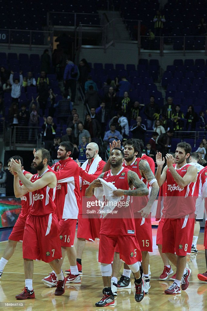 <a gi-track='captionPersonalityLinkClicked' href=/galleries/search?phrase=Vassilis+Spanoulis&family=editorial&specificpeople=704857 ng-click='$event.stopPropagation()'>Vassilis Spanoulis</a> #7 , <a gi-track='captionPersonalityLinkClicked' href=/galleries/search?phrase=Kostas+Papanikolaou&family=editorial&specificpeople=5969202 ng-click='$event.stopPropagation()'>Kostas Papanikolaou</a> #16 , Giorgos Printezis #15, <a gi-track='captionPersonalityLinkClicked' href=/galleries/search?phrase=Acie+Law&family=editorial&specificpeople=801584 ng-click='$event.stopPropagation()'>Acie Law</a> #5, Stratos Perperoglou #8 , Antic Pero #6 of Olympiacos Piraeus celebrate after they won the 2012-2013 Turkish Airlines Euroleague Top 16 Date 13 between Fenerbahce Ulker Istanbul v Olympiacos Piraeus at Fenerbahce Ulker Sports Arena on March 29, 2013 in Istanbul, Turkey.