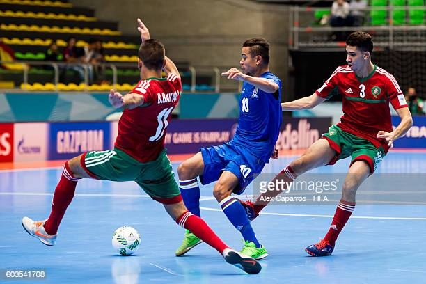 Vassoura of Azerbaijan fights for the ball with Bilal Bakkali and Mohamed Jouad of Morocco during the FIFA Futsal World Cup Group F match between...